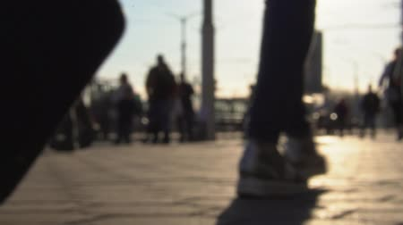on the go : People walk through the city. Slow motion. Blurred Background