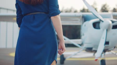 фон : Young woman coming to a light-engine private plane