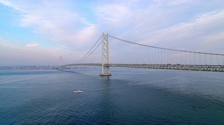 akashi strait : Aerial Ascending Akashi Kaikyo Bridge seen from Awaji Island Stock Footage
