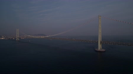 akashi strait : Aerial Full view of the Akashi Kaikyo Bridge right after sunset Zoom out
