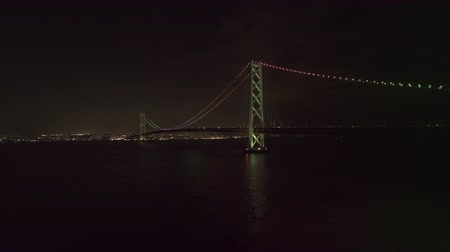 akashi strait : Aerial Ascending Akashi Kaikyo Bridge at night seen from Awaji Island