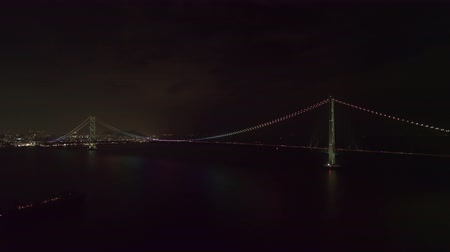 akashi strait : Aerial Full view of the Akashi Kaikyo Bridge at night Zoom in Stock Footage
