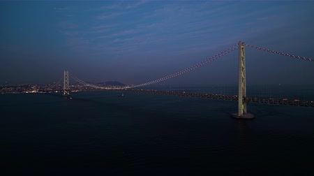 akashi strait : Aerial Full view of the Akashi Kaikyo Bridge right after sunset Zoom in