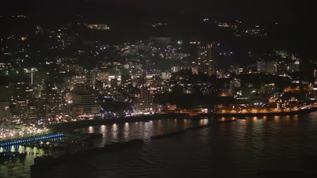 night scape : Night view of Atami hot spring city Pan right to left Stock Footage