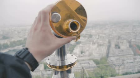 urban exploration : Sightseeing telescope on Eiffel Tower, Paris, France. View of Paris from the upper balcony in the spring March day Stock Footage