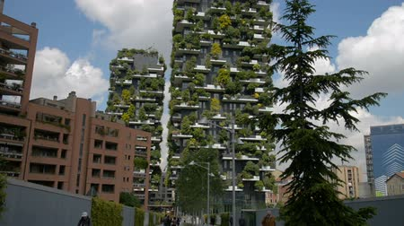 verticale : Milan, Italy - May 2017: Bosco Verticale or Vertical Forest is the Best tall building worldwide. Is composed of two residential towers with a large variety of trees and plants on the balconies. Stock Footage