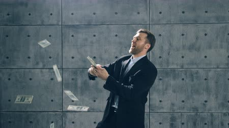 throw : Man in formal suit dancing and throwing money Stock Footage