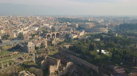 amphitheatre : Aerial view of Colosseum and ancinet Roman ruins Stock Footage