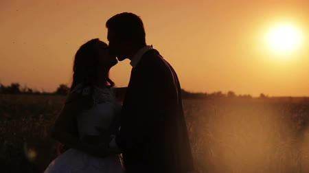 zengin : silhouette of the  bride and groom at sunset