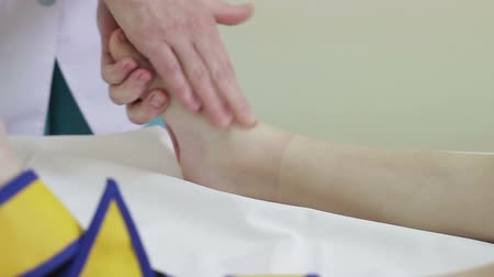 newborn child : baby massage, massaging the feet of a child in kindergarten