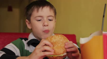 delicious : Closeup of children mouth eating hamburger