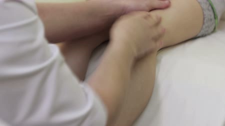 preschool : baby massage, massaging the feet of a child in kindergarten