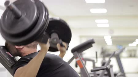 retouched : man has been in the gym training for bodybuilding pumping muscles Stock Footage