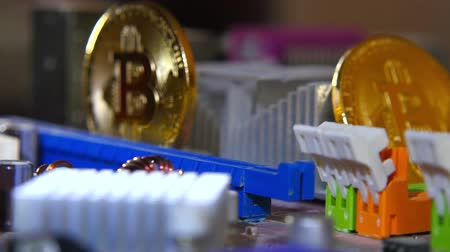 hdd : Gold bitkoyn on the background of the motherboard. Video close up. The concept of virtual money. Stock Footage