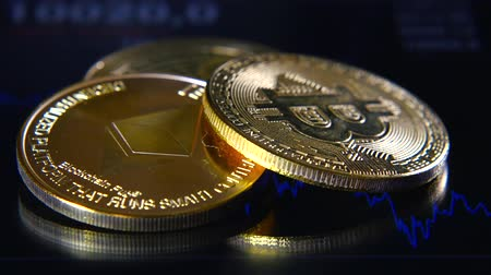 Golden bitcoins on the background of a graphic stock chart. The Concentration of the Crypto-Currency of Virtual Money Stock Footage