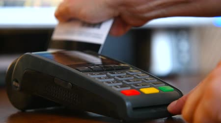 Female hand with a bank card using the terminal for payment. The concept of non-cash payment Stock Footage