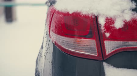 day. car Blinker light. emergency flashing lamp car during a snowfall 4k.