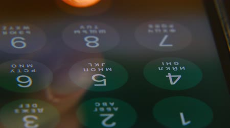 girl dials a number on the smartphone, video close-up