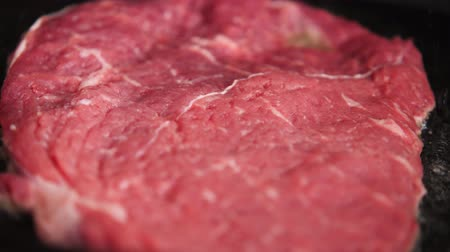 Cooking a juicy slice of steak. Stock Footage