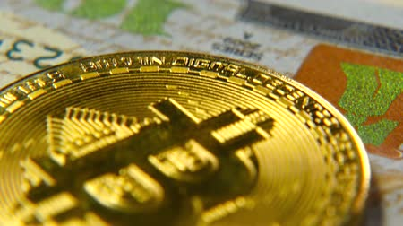 us banknotes : Gold bitcoins and dollars. New and old money. Virtual money Stock Footage