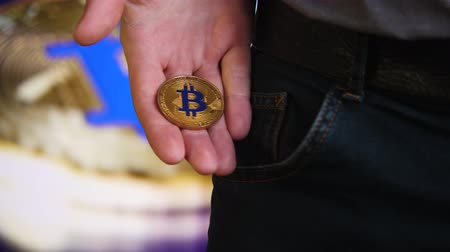 Bitcoin in the hands of a businessman Stock Footage