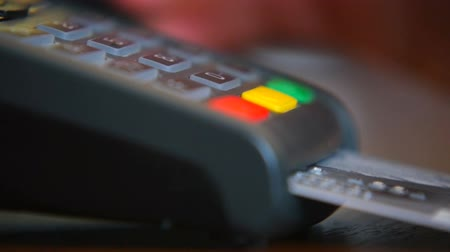 card pin : Female hand with a bank card using the terminal for payment. The concept of non-cash payment Stock Footage