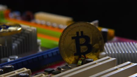 New crypto currency, gold coins bitcoin on the motherboard
