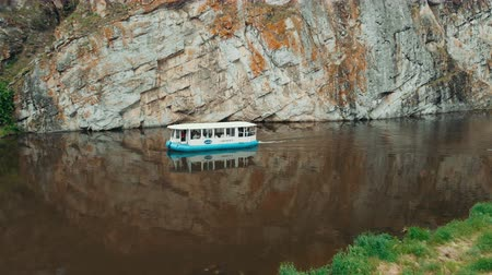 parník : drone shot river boat sails on the mountain river. River tram. water tourism