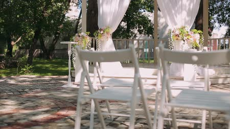 settings : wedding decoration, wedding reception set outdoors under bright sun on resort Stock Footage