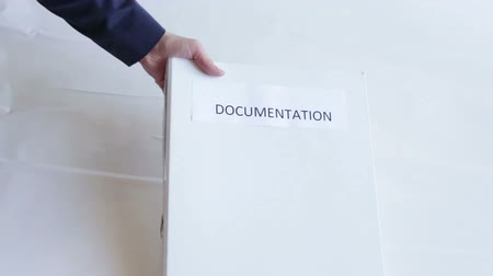 dosya : The businessman passes a folder. The woman takes documentation. Peoples hands. Business concept. Stok Video