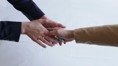 vesztegetés : The problem of corruption in business. A man gives a woman money. Handshake businesspersons. Stock mozgókép