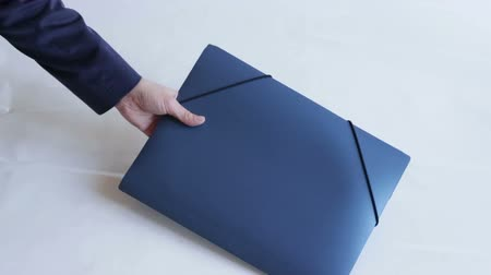документация : The man passes a blue folder. The woman takes the documents. Peoples hands. Business concept.