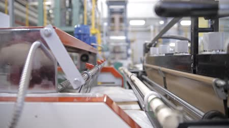 industry : Video shows a factory, producing plastic bags. Equipment is at work.
