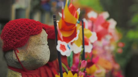 Buddhist Ojizo statues at Zojoji Temple in Tokyo Japan. Macro dolly shot. Stok Video