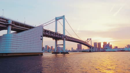 tower bridge : Tokyos famous Rainbow Bridge taken from a boat on the Sumida River at sunset