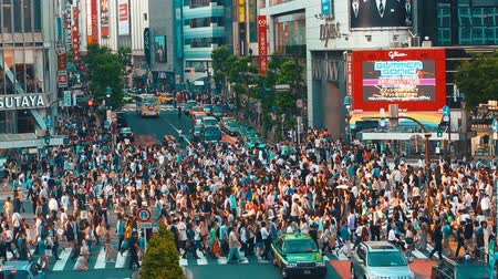 crowded : People and vehicles cross the famous Shibuya intersection in Tokyo in time lapse on May 23, 2014.The Shibuya scramble crosswalk is one of the busiest intersections in the world.