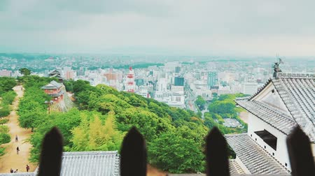samuraj : View of a Japanese city from an ancient castle window above