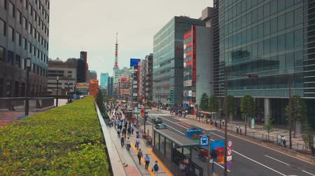 businness :  People walking in the Minato ward of Tokyo, Japan outside Daimon Station. This section of Minato is home to 49 foreign embassies Stock Footage