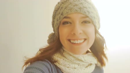 mittens : Video of young woman dressed for winter taking a selfie