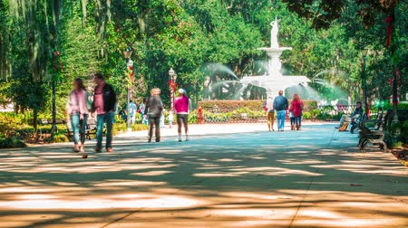 ga : Timelapse of the iconic Forsyth Park fountain in Savannah, GA with people strolling in the park