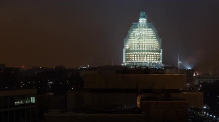 united states : Timelapse of the United States Capitol building at night under renovation