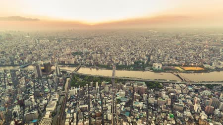 tokio : Sunset time-lapse high above Tokyo, Japan from the Tokyo Skytree, the worlds tallest freestanding broadcasting tower. Wideo