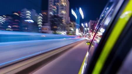 быстрый : Point of view time-lapse hyperlapse  through the city at night by taxi. Tokyo, Japan