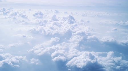 puffy clouds : Aerial view of clouds shot from aircraft in very steady slow motion.