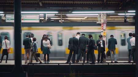 japan : People waiting to board trains at the subway station in Tokyo, Japan Stock Footage