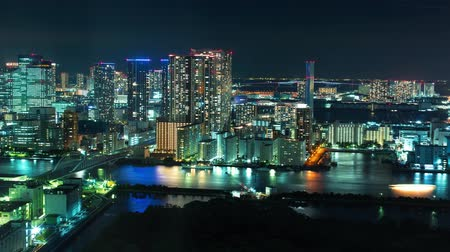 futuristický : Time-lapse of Tokyo Bay at night with boats