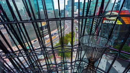 небоскреб : Time-lapse of Ginza, Tokyo as seen through the metal facade of a shopping mall
