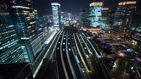 train station : Aerial view of trains arriving and departing Tokyo Station in Marunouchi, Tokyo, Japan