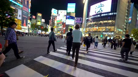 TOKYO, JAPAN - SEP, 25 2017: People cross the famous intersection in Shibuya, Tokyo, Japan one of the busiest crosswalks in the world.