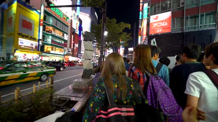 steady cam : TOKYO, JAPAN - SEP, 25 2017: People cross the famous intersection in Shibuya, Tokyo, Japan one of the busiest crosswalks in the world.